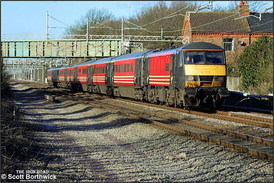 90006 'Modern Railways Magazine/Roger Ford' works a short formed London Euston bound service at Cathiron on 04/02/2003. On the date this photograph was taken, Scotland was experiencing severe adverse snowy weather and locomotives were required to haul, rather than propel trains. This resulted in a number of sets either having the locomotive hauling the DVT or the set facing the wrong way if it had been turned, resulting in the locomotive being on the London end of the train, rather than the usual country end.
