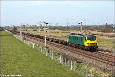 """Unbranded 90046 passes Barby Nortoft with 4L75 1124 Crewe Basford Hall-Felixstowe North FLT consisting of """"fresh air"""" on 16/03/2009."""