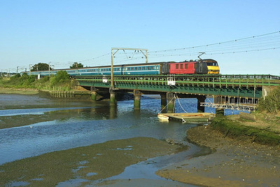 Scruffy 90012 crosses Manningtree Viaduct with 1P59 1800 Norwich-London Liverpool Street on 06/07/2004.