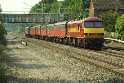 90017 speeds past Cathiron on 13/06/2003 whilst in charge of 1A90 1532 Warrington RMT-Willesden PRDC.