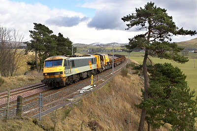 On weekdays the locomotive that works the sleeper from London Euston to Edinburgh Waverley is employed on a 'fill in' move whilst awaiting to work the southbound sleeper later in the day. The loco works 6M49 0937 Millerhill SS-Carlisle NY & 6S50 1305 Carlisle NY-Millerhill SS departmental services. Here 90036 is pictured between Crawford & Abington in the Scottish Borders working 6S50 1305 Carlisle NY-Millerhill SS on 04/03/2005. On this day the service comprised a trainload of continuously welded rail.