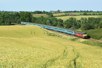 90019 is pictured in rural scenery at Brantham on 06/07/2004 working 1P51 1600 Norwich-London Liverpool Street.