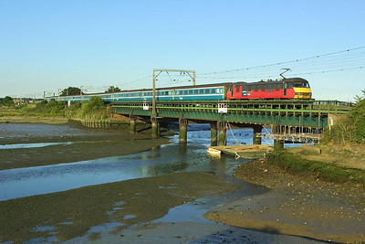 90019 propels 1P52 1830 London Liverpool Street-Norwich across Manningtree Viaduct on 06/07/2004.