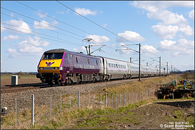 91101 passes Broad Fen Lane, Claypole whilst in charge of 1D17 1405 London King's Cross-Leeds on 03/04/2013.