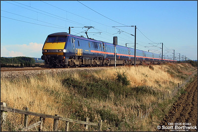 91124 'Reverend W Awdry' races northwards at Frinkley Lane, Marston with 1D31 1640 London Kings Cross-Leeds on 06/09/2003.