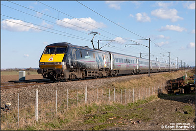 91110 'Battle of Britain Memorial Flight' passes Broad Fen Lane, Claypole whilst working 1D20 1535 London King's Cross-Leeds on 03/04/2013.