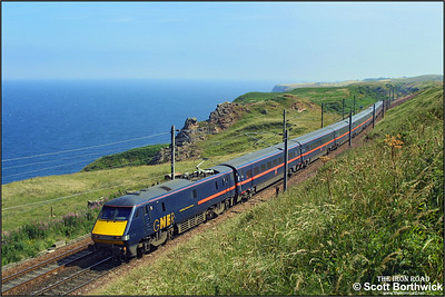 91121 'Archbishop Thomas Cranmer' races north along the Berwickshire coastline section of the ECML at Lamberton whilst working 1S21 1100 London Kings Cross-Glasgow Central on 14/7/2003.