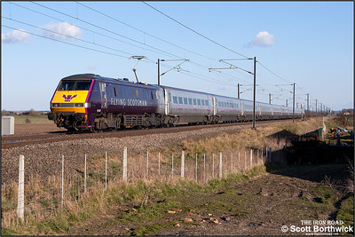91101 passes Broad Fen Lane, Claypole whilst propelling 1A41 1645 Leeds-London King's Cross on 03/04/2013.