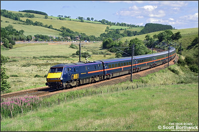 Running around 40 minutes late, 91121 'Archbishop Thomas Cranmer' heads 1S18 1000 London Kings Cross-Edinburgh Waverley at Houndwood on 11/07/2003.