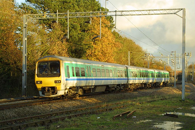 323221 approaches Berkswell with a Coventry-Birmingham New Street 'all stations stopper' on 01/12/2001.