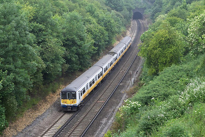 South Central  liveried 319002 heads towards Quarry Tunnel whilst forming 1T18 1104 Brighton-Bedford on 20/06/2005.