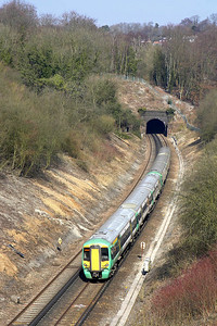 377309+377313 are pictured exiting Quarry Tunnel whilst forming 1A50 1106 London Victoria-Brighton on 23/03/2006.