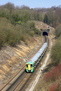 377135 is pictured after exiting Quarry Tunnel on 23/03/2006 whilst working 5C00 1049 Selhurst T&RSMD-Horsham ECS.