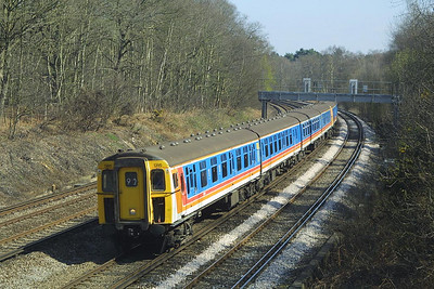 Class 421/8 & 421/5 (both 4-CIG's), 1395+1301 are pictured near Pirbright Junction on 04/04/2003.