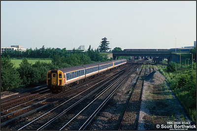 A class 421/4 (4-CIG) and 421/3 (4-CIG) pairing of 1805+1744 forms the 1706 Bognor Regis/1636 Portsmouth Harbour-London Victoria service at Gatwick Airport on 26/05/1992. The two units combined at Barnham, the junction for the Bognor Regis branch, for the run up to London.