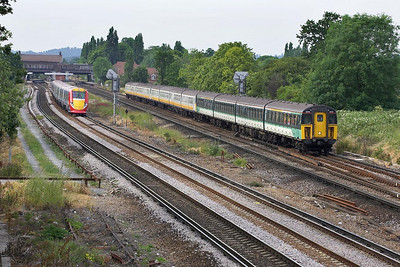 The old and the new side by side pictured shortly after passing through Horley on 20/06/2005. Two Class 423/1 4-VEP's lead a Class 423/2 4-VOP, 3514+3821+3916 working 1F81 1745 London Bridge-Eastbourne overtake 460003 working 1D72 1745 London Victoria-Gatwick Airport.