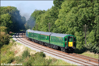 4 BIG, 7059 is propelled by D6535 (33116) at Kinchley Lane whilst forming 2C30 1445 Quorn & Woodhouse-Rothley Brook on 12/09/2009.