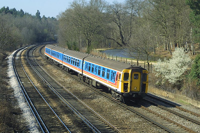 Class 421/8 4-CIG, 1395 heads towards London at Pirbright Junction on 04/04/2003.