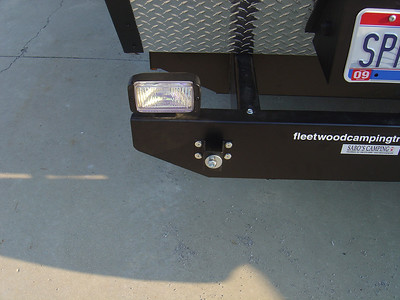 Left back up light bolted to the bumper.