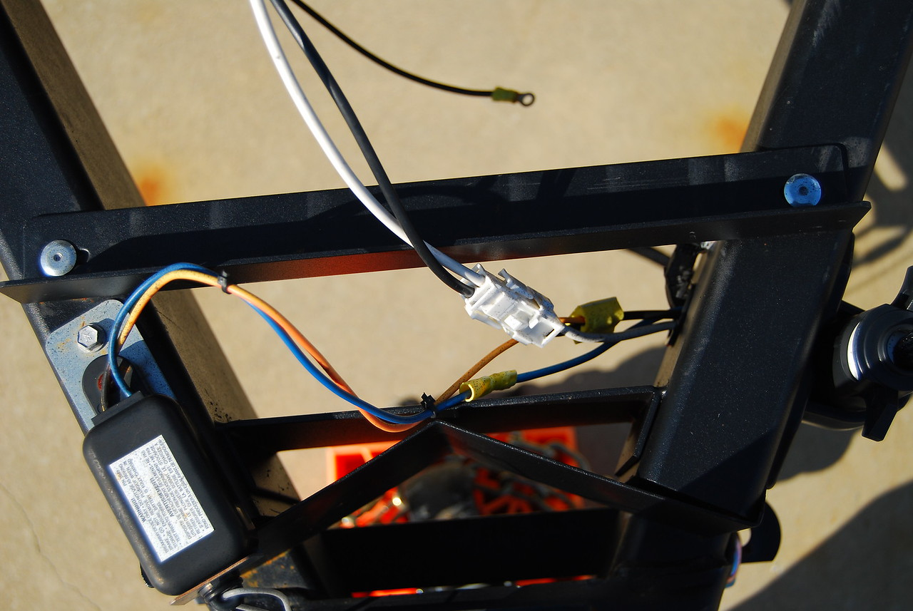 Battery wiring harness.  Black (positive) and white (negative) wires go to the battery and the other end to the converter via the quick disconnect (white). The orange wire goes from the black (positive)  to the trailer disconnect switch (Black box on left).  THe Blue wire goes from the trailer disconnect switch to the brakes..