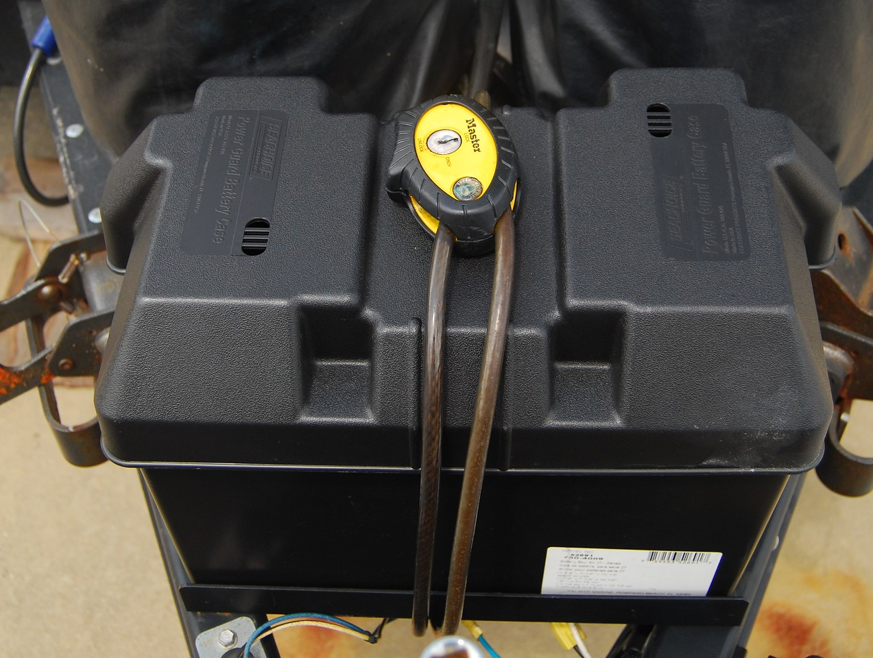 Group 29 battery in its box with cable lock