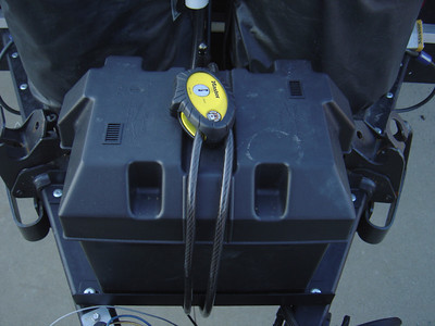 This is the original Group 24 battery and its box held in placed by a Master Lock Python adjustable cable lock.