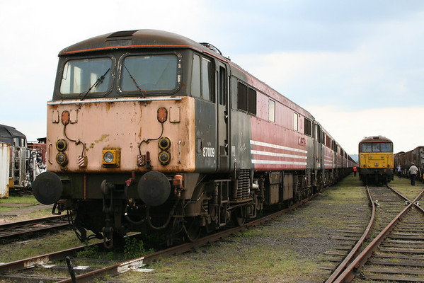 87009 leads a long line of electrics at Long Marston. 07.06.08