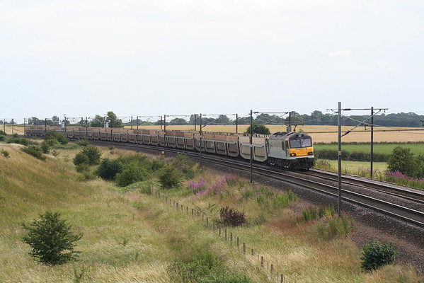 The Tuesdays only 6E28 0845 Dollands Moor - Tyne Yard passes Colton with 92011. 19.07.05