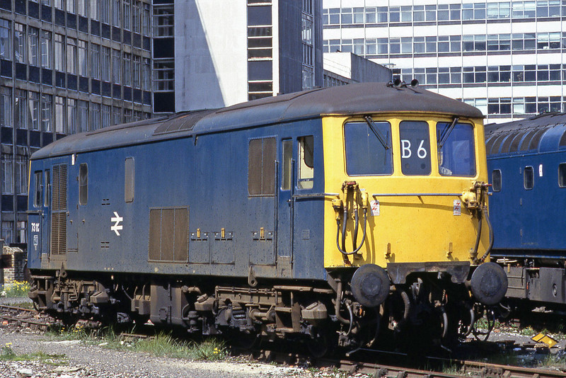 Class 73112 electro diesel stands in the sun at London Waterloo. Displaying the headcode B6 which denotes empty to Clapham Yard.