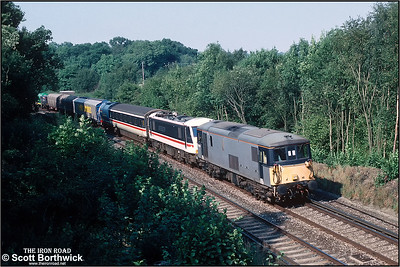 73136 passes Balcombe on 21/09/1991 hauling 90005 'Financial Times' and an assortment of wagons from Willesden Brent Sdgs to Brighton Lovers' Walk TMD for the following days open day in connection with the Brighton Line 150 celebrations.