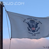 "U.S. Coast Guard Flag<br /> <br /> The flag of the United States Coast Guard is white with a dark blue Great Seal of the United States. The shield on the eagle's breast has a blue chief over vertical red and white stripes. Inscribed in an arc above the eagle is ""UNITED STATES COAST GUARD""; below the eagle is the Coast Guard motto, ""SEMPER PARATUS"" (""Always Ready"") and beneath that the numerals 1790 the year in which the service's ancestor, the U.S. Revenue Cutter Service, was founded. All inscriptions are dark blue."