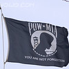 POW-MIA Flag<br /> <br /> In 1971, Mrs.Mary Hoff, an MIA wife and member of the National League of American Prisoners and Missing in Southeast Asia, recognized the need for a symbol of our POW/MIAs. Prompted by an article in the Jacksonville, Florida TIMES-UNION, Mrs. Hoff contacted Norman Rivkees, Vice-President of Annin & Company which had made a banner for the newest member of the United Nations, the People's Republic of China, as a part of their policy to provide flags to all UN member nations. Mrs. Hoff found Mr. Rivkees very sympathetic to the POW/MIA issue, and he, along with Annin's advertising agency, designed a flag to represent our missing men. Following League approval, the flags were manufactured for distribution.  The flag is black, bearing in the center, in black and white, the emblem of the League. The emblem is a white disk bearing in black silhouette the bust of a man, watch tower with a guard holding a rifle, and a strand of barbed wire; above the disk are the white letters POW and MIA framing a white 5-pointed star; below the disk is a black and white wreath above the white motto YOU ARE NOT FORGOTTEN.  The importance lies in the continued visibility of the symbol, a constant reminder of the plight of America's POW/MIA'S.  This flag flew on the Lake Erie Shore January, 2013.