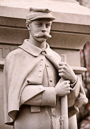I'll be watching you by Lora Mosier<br /> <br /> This soldier stands at the ready rain or shine, day or night on the square in Elyria, Ohio.