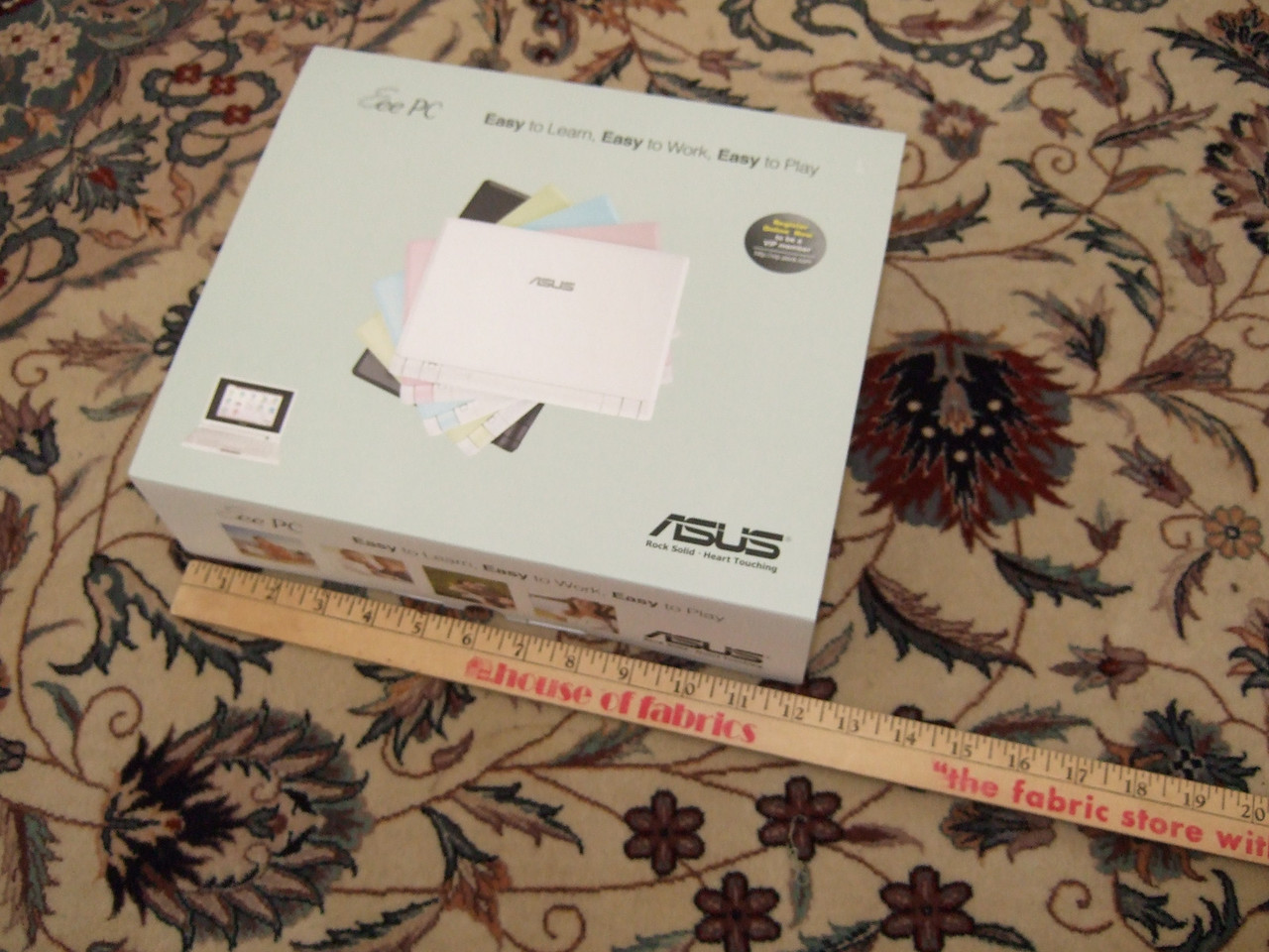This is the box the EEE PC comes in. The ruler is a yardstick measuring in inches.