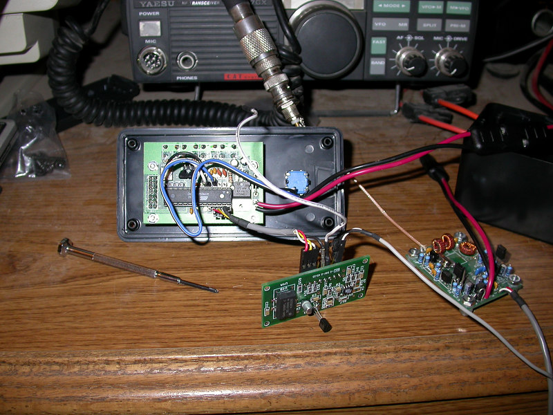 Inside view of box showing back of controller.  Small card in center is the DDS-60 (note the temporary TO-29 package voltage regulator due to my earlier mistake).  Softrock V6 is on the right.