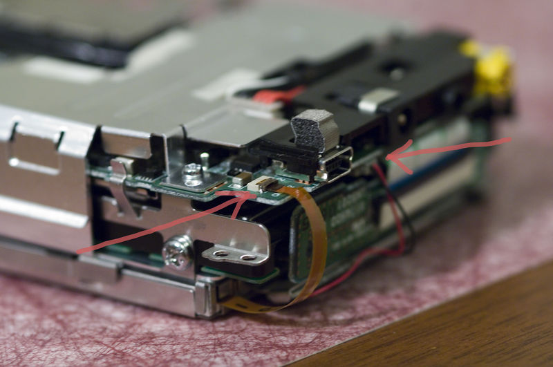 The ribbon cable and red/black wires need to be disconnected since they block acess to the hard drive.