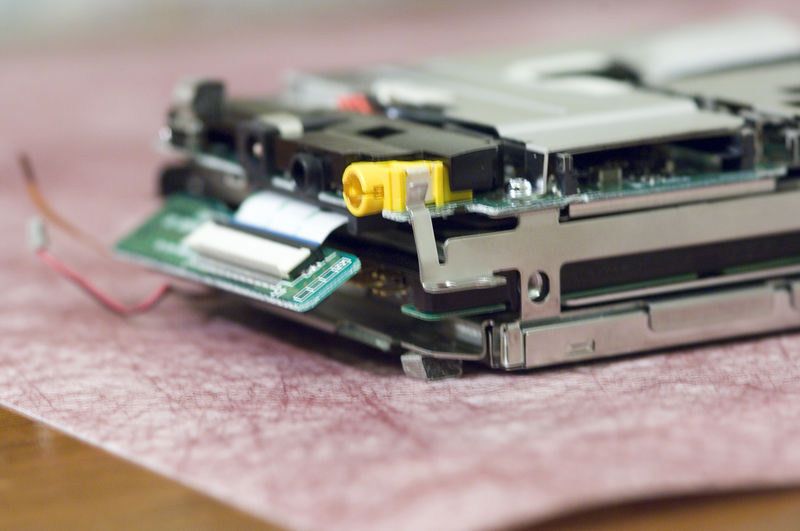Lift the rectangle piece and start to slide the hard drive out