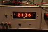 Close up of illuminated nixie tube display.  Stacked number cutouts are visible, but not anywhere near as distracting as one might expect after looking at a tube that's not lit.