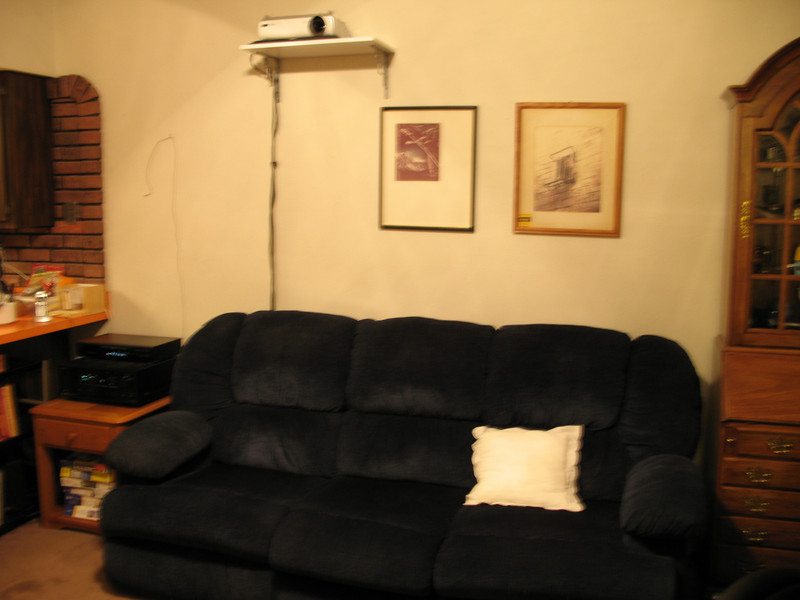 Projector on its shelf above the couch