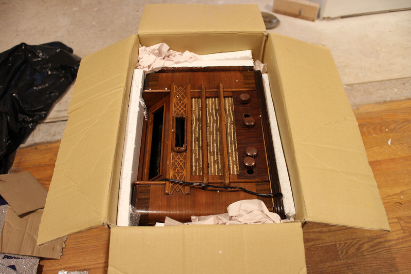 Radio in box as opened - note loose knobs and tuning scale/pushbuttons not in proper locations.