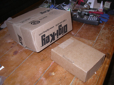 Shipping box size for mouser (unmarked) and Digikey (upside-down) compared.