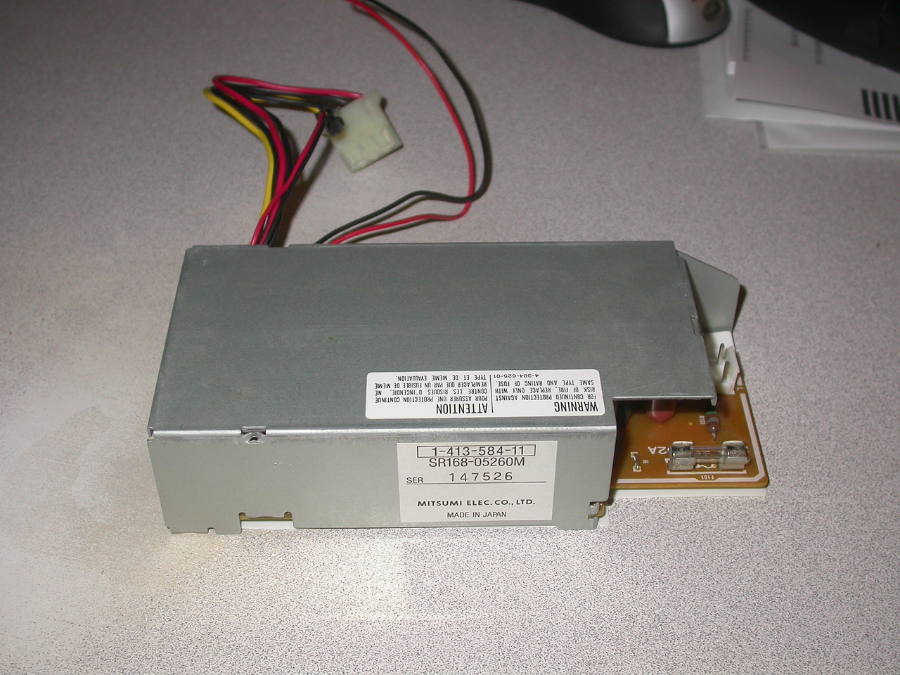 Power supply in it's case.  I've searched on the part numbers but haven't confirmed any specs for it.