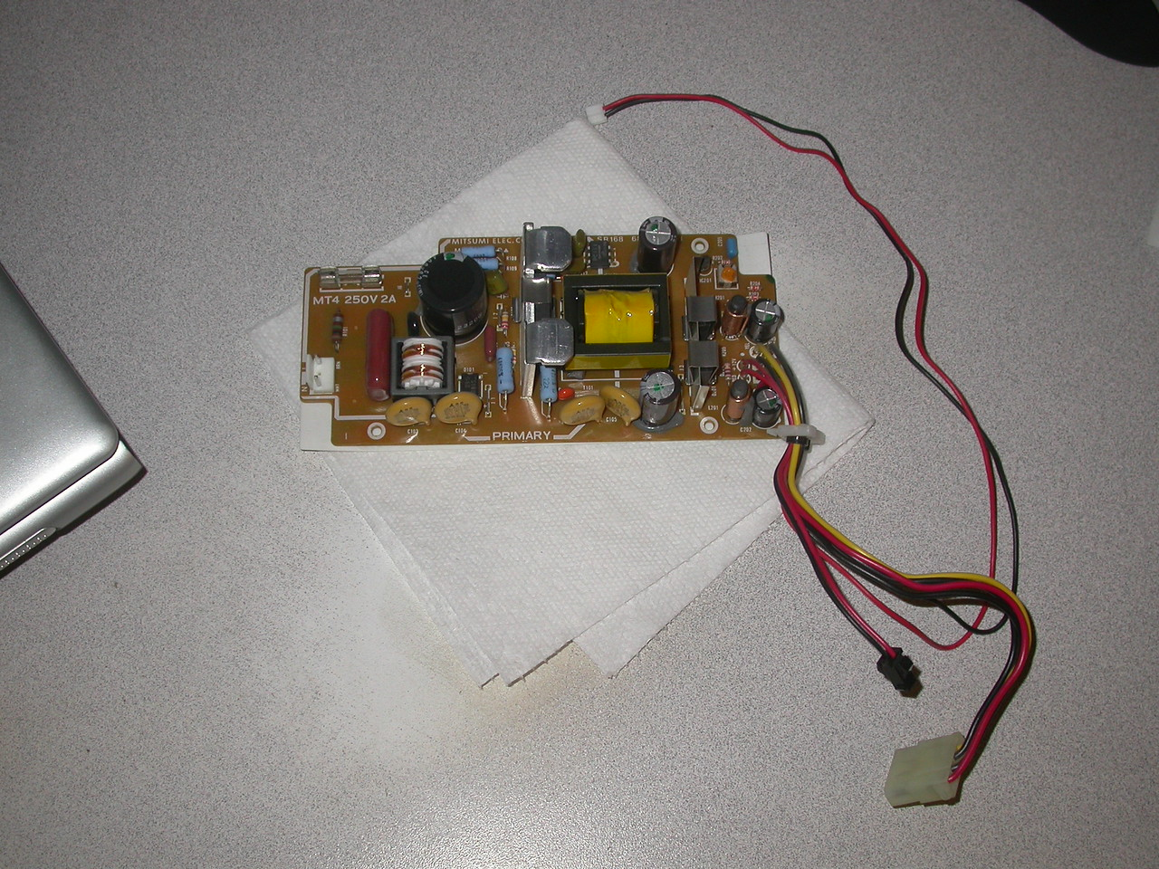 Power supply from the case.  Long power line is current limited to run an LED, drive cable has +5v on red and +12 on yellow.