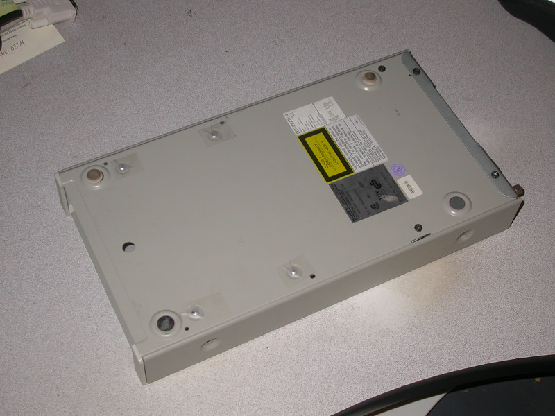 Bottom of case still featuring Laser warnings from the CD-Drive mechanism.