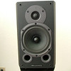 Wharfedale Diamond 9.1 without cover. For a small speaker they fill the room without any trouble.