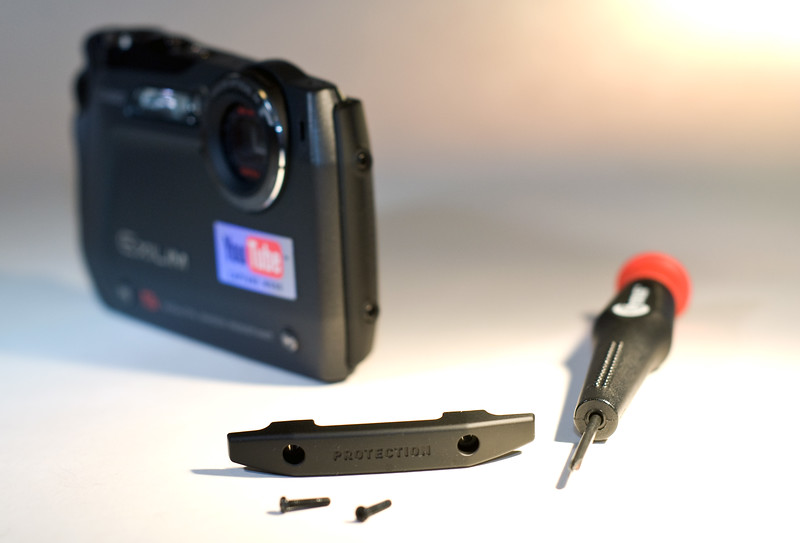 To make the Exilim even more bump-resistant, reach for a #0 screwdriver (not supplied) and attach a protector, which comes with the camera, on the lens side of the EX-G1.