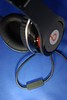 "The microphone built into one of the two supplied cables turns the ""Beats"" into a headset that can be used with many mobile phones."