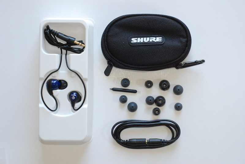 Contents of the SE115 packaging box: the cord is shorter (and, of course, missing the controls), so Shure provides not only a variety of earpieces but also an extension cord.