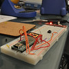 Breadboard with teensy, power supply, and soldering iron in the background.