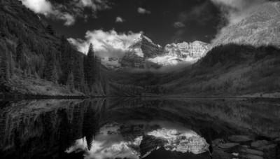 """Maroon Bells Misty Morning""  Maroon Bells National Recreation Area, CO  In 2008 I spent a week up in Colroado phtogoraphing the Fall colors.  One of my favorite locations of the trip was the Maroon Bells area.  In this image, Pyramid Peak is reflected on the still waters of the lake.  I chose to shoot Infrared here in order to capture the subtle tones of the shadows. Technical Details: Shot with IR modified Canon 10D and Canon 20mm lens at F16 and 1/40.    Panorama created from 6 vertical bracketted shots."